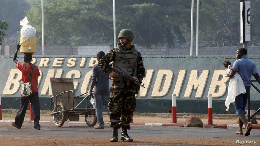 A Moroccan soldier from the peacekeeping forces secures a street in Bangui, Central African Republic, Feb. 20, 2014.