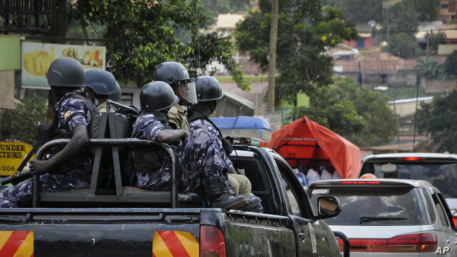 FILE - Ugandan riot police patrol on the streets of the Kamwokya neighborhood.