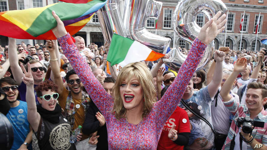"""Rory O'Neill, known by the Drag persona Panti, celebrates with """"yes"""" supporters at Dublin Castle, Ireland, May 23, 2015."""