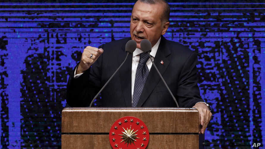 Turkey's President Recep Tayyip Erdogan announces plan of action for the first 100 days of his new presidency, in Ankara, Turkey, Friday, Aug. 3, 2018.