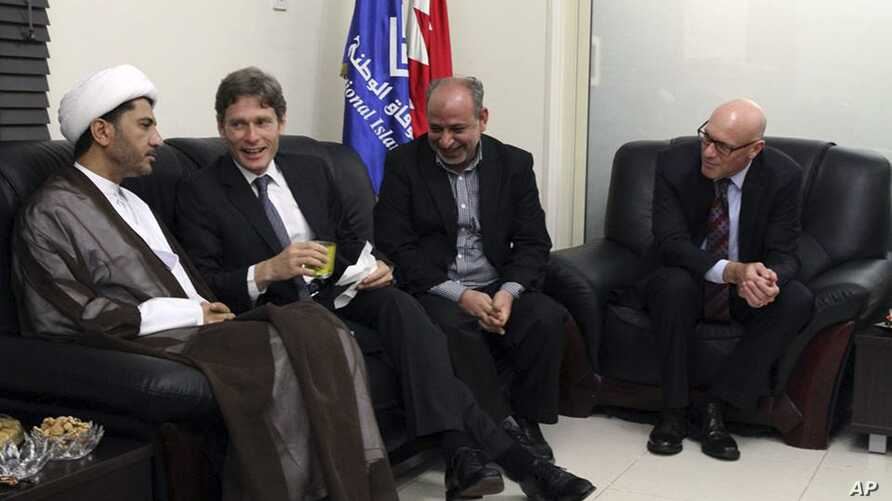 U.S. Assistant Secretary of State for Democracy, Human Rights and Labor Tom Malinowski (2nd L), visits with Sheikh Ali Salman, head of Wifaq National Islamic Society (L), former member of the Bahraini parliament, Abdul Jalil Khalil (2nd R), Timothy J