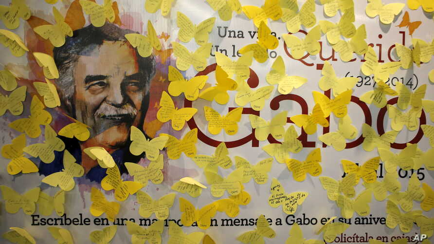 FILE - Yellow paper butterfly cutouts with messages are seen on a banner with an image of Nobel Prize-winning novelist Gabriel Garcia Marquez, on the first anniversary of his death, at a bookstore in Mexico City, Mexico, April 17, 2015.