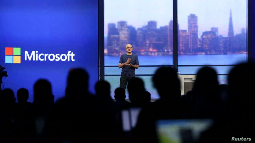 """FILE - Microsoft CEO Satya Nadella speaks during his keynote address at the company's """"build"""" conference in San Francisco, California."""
