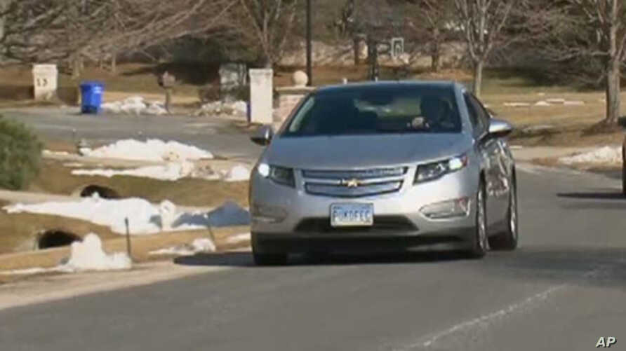Lawyer Jeff Parmet, behind the wheel of his Volt, says he hasn't pumped gas since buying the electric car in December.