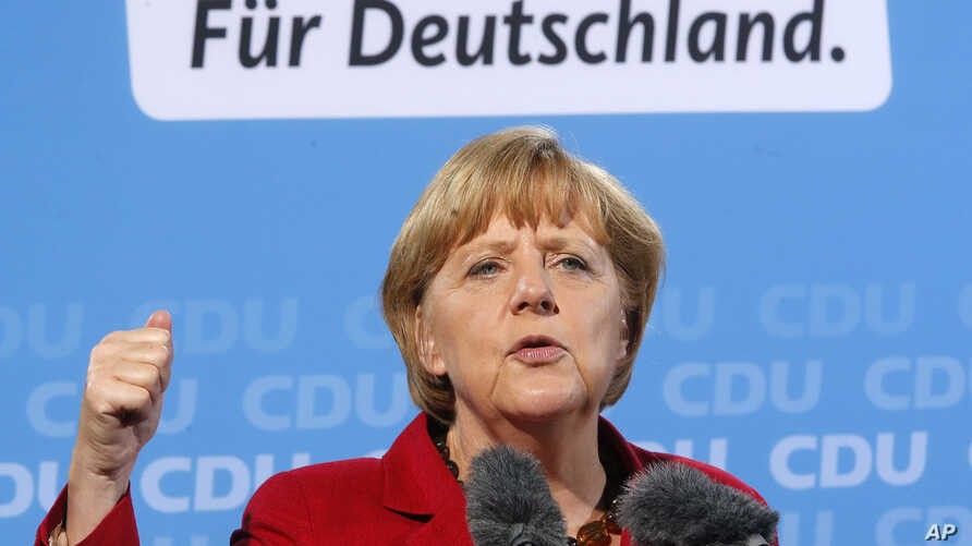 German Chancellor and CDU top candidate Angela Merkel speaks during an election campaign meeting in Giessen, Germany, Sept.4, 2013.