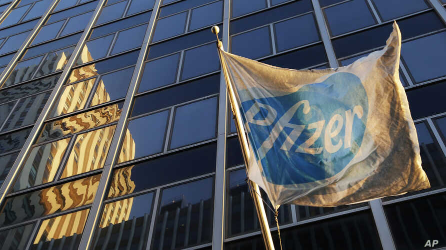 A Pfizer flag is displayed in front of world headquarters in New York, Nov. 23, 2015.