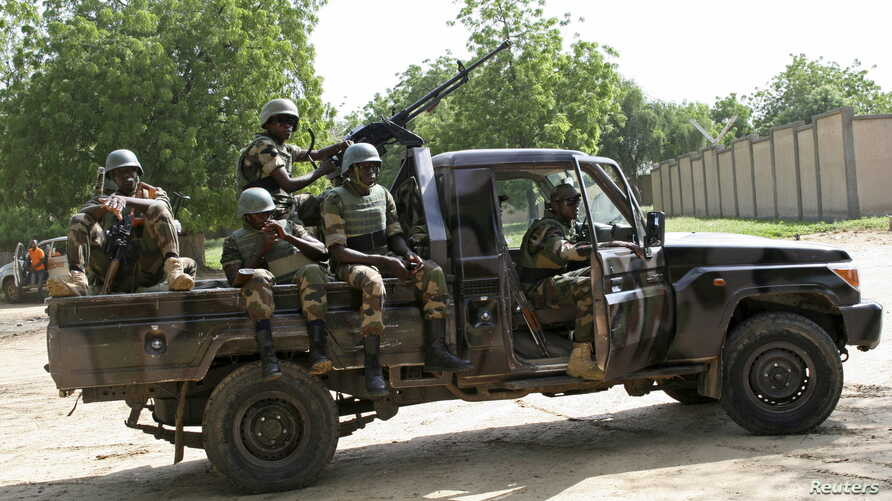 FILE - Niger soldiers provide security for an anti-Boko Haram summit in Diffa city, Niger, Sept. 3, 2015. Niger said Nov. 5, 2015, it had bombed a Boko Haram base in the country's southeast and arrested more than 20 militants.