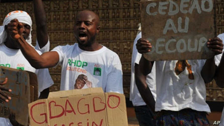 Supporters of Ivory Coast's internationally recognized leader Alassane Ouattara demonstrate on December 28, 2010 at the Golf Hotel in Abidjan.