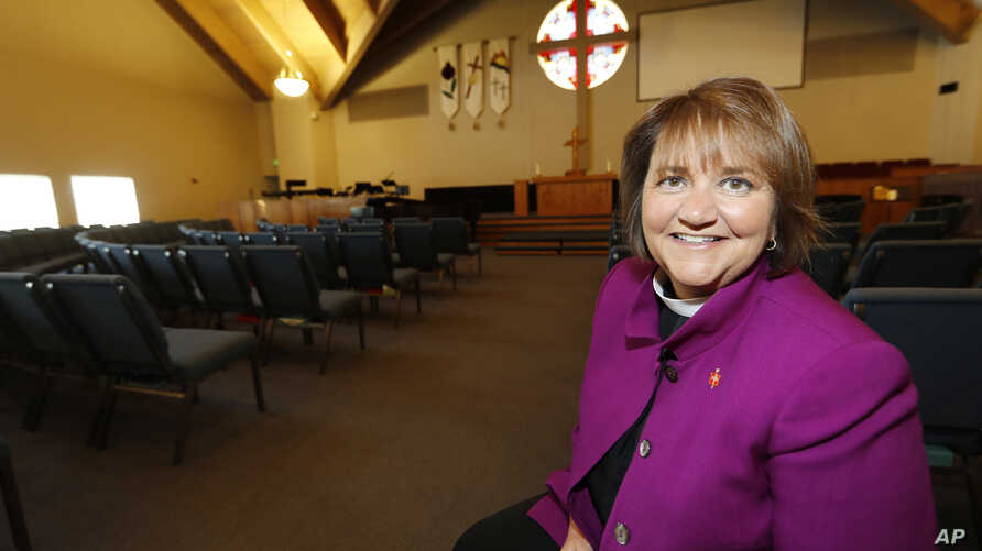 Bishop Karen Oliveto in the sanctuary of a United Methodist Church near her office in Highlands Ranch, Colo., April 19, 2017. On Tuesday, the highest court in the United Methodist Church considered whether to invalidate the election of the denominati