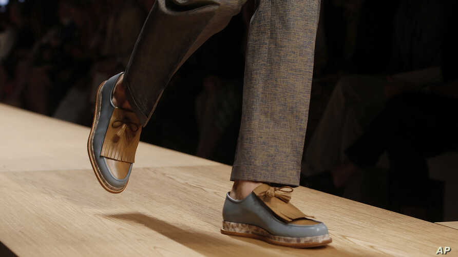 FILE - Footwear by Italian shoemaker Salvatore Ferragamo is being introduced at a fashion show.