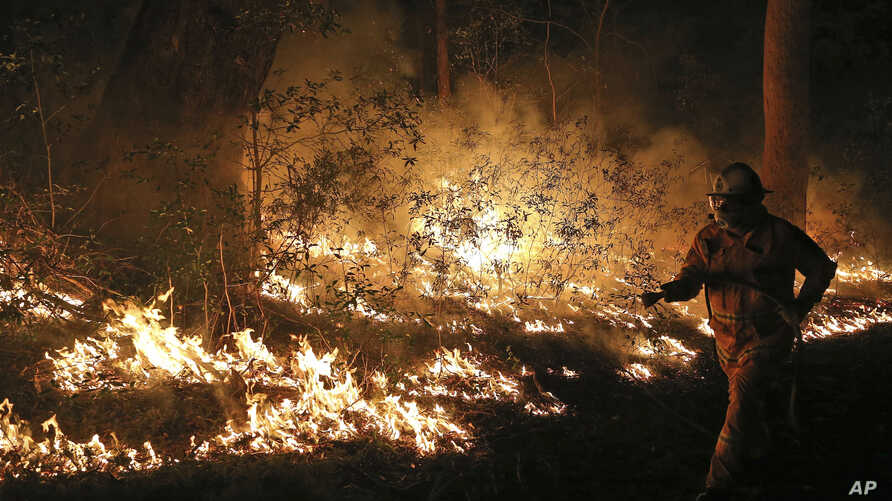 Firefighters control flames during hazard reduction in Bilpin, Australia, Oct. 23, 2013.