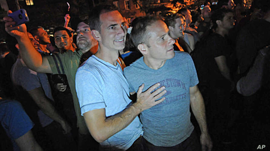 Carl Bazil and Eric Price celebrate in Manhattan's west village following the passing of the same-sex marriage bill by the New York Senate, June 24, 2011