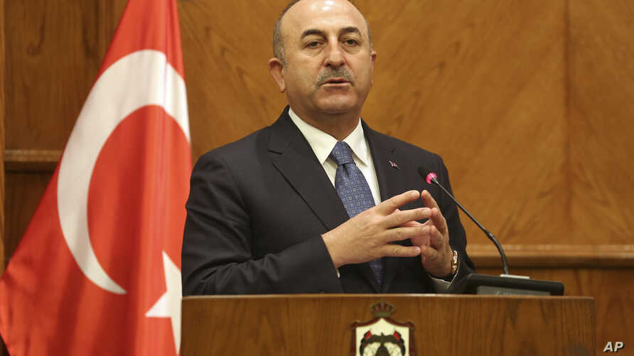 Turkish Foreign Minister Mevlut Cavusoglu, and Jordanian Foreign Minister Ayman Safadi (not shown), give a press conference in Amman, Jordan, Feb. 19, 2018. Cavusoglu said his country is ready to battle Syrian government troops if they enter an encla