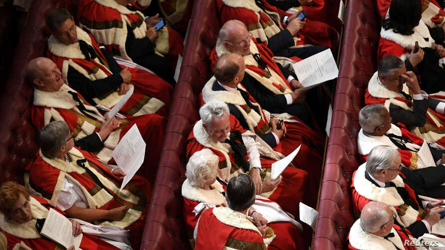FILE - Members of the House of Lords are seen seated in Parliament, in central London, Britain, June 21, 2017.