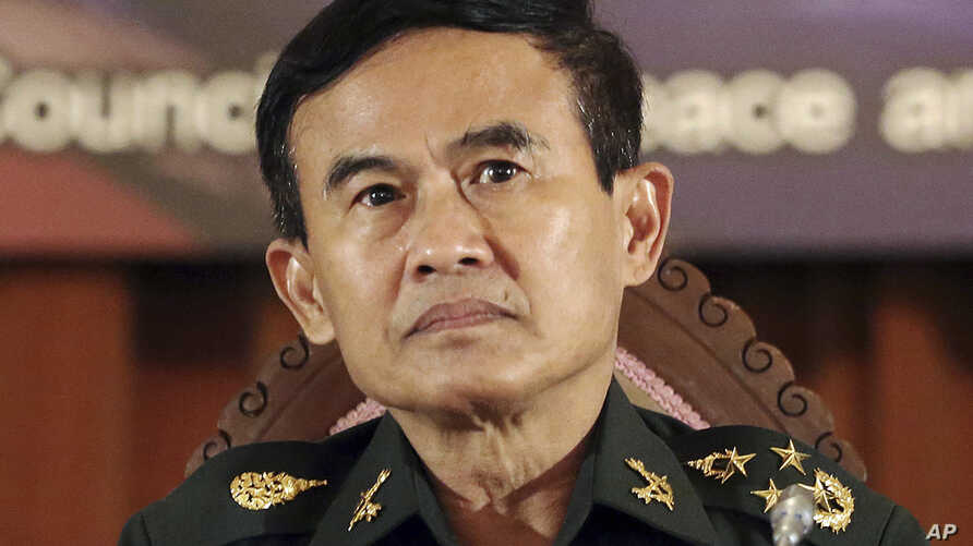 Secretary-General of the National Council for Peace and Order (NCPO) Gen. Paiboon Koomchaya, who also in charge of legal and justice affairs, listens to questions during a news conference at the Government House in Bangkok, Thailand, July 23, 2014.
