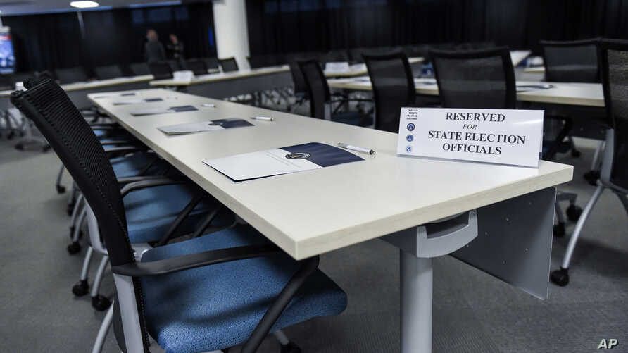 FILE - This room in Bethesda, Md., was prepared Feb. 16, 2018, for election officials from all 50 states to attend the first of two classified briefings being held to raise awareness of foreign meddling in state election systems. The briefings were h