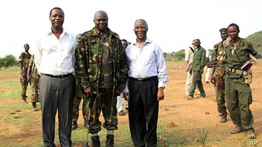 A picture released by Thabo Mbeki's spokesman shows former President of Burundi Pierre Buyoya and AU mediator for the Sudan crisis Thabo Mbeki  with Sudan People's Liberation Army (SPLA) commander, Abdel Aziz al-Hilu (C), at his military headquarters