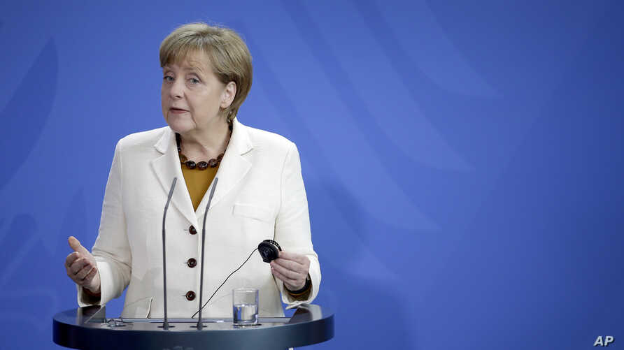 German Chancellor Angela Merkel gestures during a joint press conference with Prime Minister of Finland Alexander Stubb (not pictured), at the chancellery in Berlin, Germany, Sept. 29, 2014.
