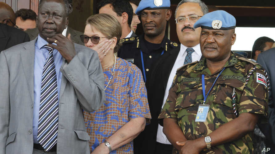 United Nations Mission in South Sudan (UNMISS) force commander Lt. Gen. Johnson Mogoa Kimani Ondieki of Kenya, right, stands next to Ellen Loj, center, Special Representative of the UN Secretary-General, as they await a delegation of U.N. Security Co