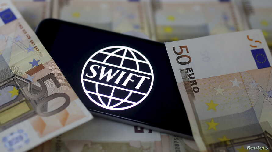 Swift code bank logo is displayed on an iPhone 6s on top of Euro banknotes in this picture illustration made in Zenica, Bosnia and Herzegovina on January 26, 2016.