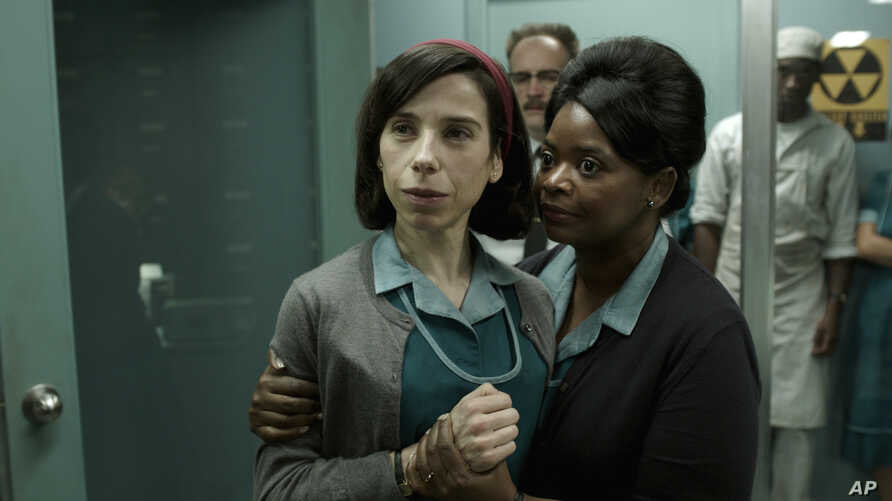 """FILE - This image released by Fox Searchlight Pictures shows Sally Hawkins, left, and Octavia Spencer in a scene from """"The Shape of Water."""" The movie premieres at the Toronto International Film Festival."""