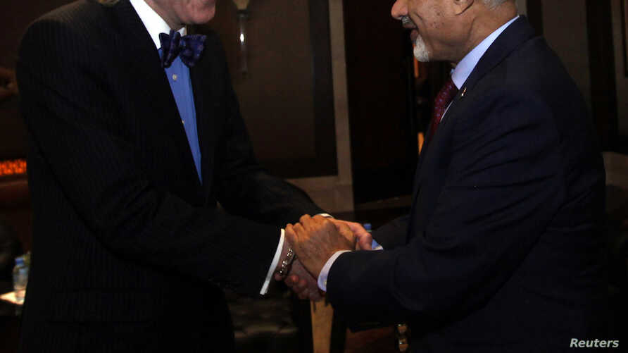 FILE - Libyan National Congress President Mohammed Magarief (R) shakes hands with Inter-Parliamentary Union Secretary-General Anders Johnsson (L) in Tripoli.