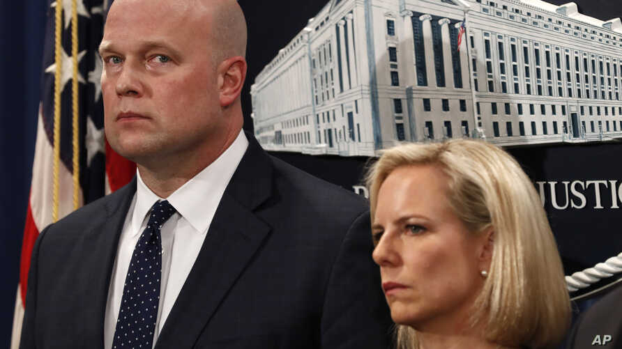 Acting Attorney General Matt Whitaker, left, and Homeland Security Secretary Kirstjen Nielsen, attend an announcement about an indictment on violations including bank and wire fraud, Monday, Jan. 28, 2019, of Chinese telecommunications companies incl
