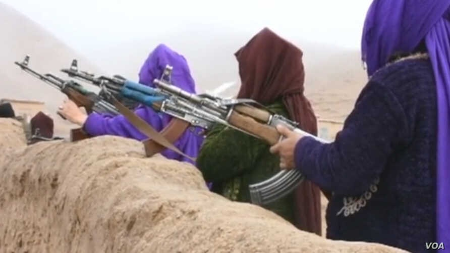 Afghan women who lost male family members in northern Jawzjan province of Afghanistan joined forces to fight Taliban and IS militants. (M. Bezhan/VOA)