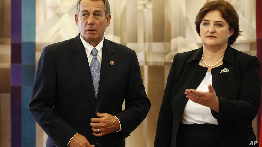 Speaker of the United States House of Representatives John Boehner, R-Ohio, left, and Lithuania's Speaker of the Parliament Loreta Grauziniene speaks during a meeting at the Parliament's palace in Vilnius, Lithuania, June 29, 2015.
