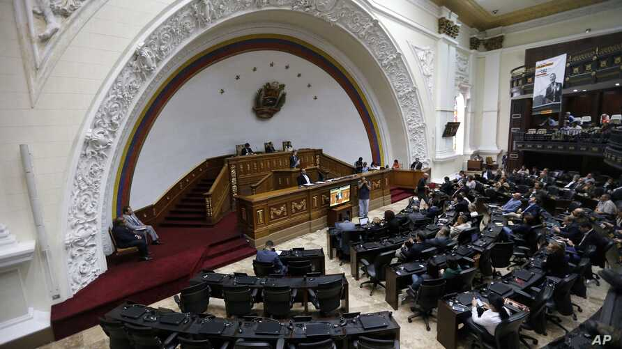 Opposition lawmaker Henry Ramos Allup speaks from the podium during a session of the National Assembly in Caracas, Venezuela, Aug. 7, 2017.