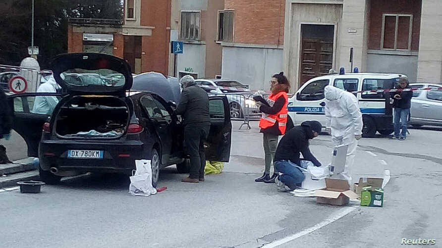 Forensics experts inspect a car used by a gunman in Macerata, Italy, Feb. 3, 2018. Forensics experts inspect a car used by a gunman in Macerata, Italy, Feb. 3, 2018.