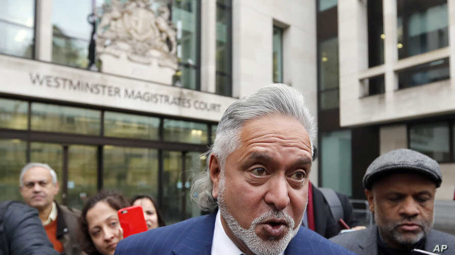 FILE - Indian tycoon Vijay Mallya leaves after attending a hearing at Westminster Magistrates Court in London, Britain Nov. 20, 2017.