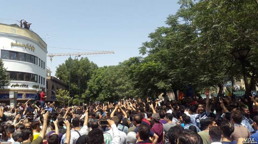 Hundreds of Iranians stage an anti-government protest in central Tehran on June 25, 2018 - the biggest such protest in years.