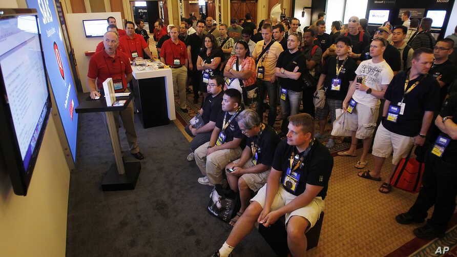 FILE - Hackers and digital security personnel attend the annual Black Hat conference for digital self-defense in Las Vegas, Aug. 4, 2011. At that time, a security researcher who is diabetic identified flaws that could allow an attacker to remotely co