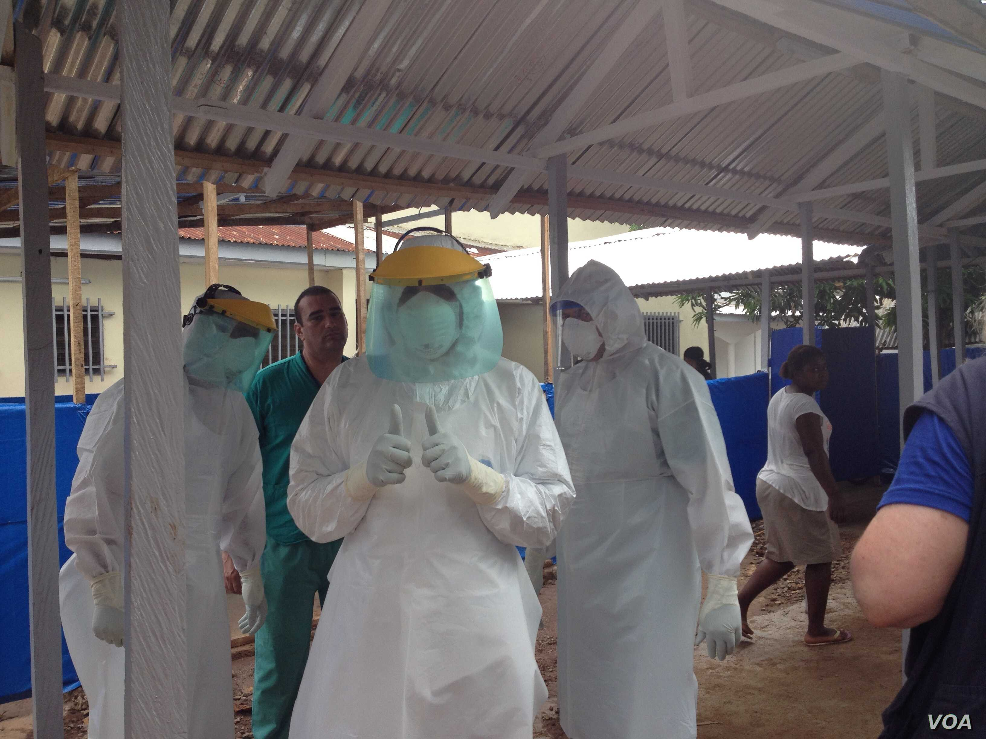 Cuban medical team training in personal protective equipment (PPE) at an Ebola center being built in Waterloo, east of Freetown, Sierra Leone, Nov. 17, 2014. (Nina deVries/VOA)