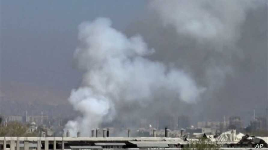 Image taken from video obtained from Shaam News Network, smoke rises from university buildings after shelling, Damascus, March 28, 2013.