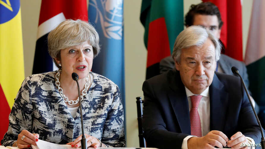 FILE - British Prime Minister Theresa May speaks while United Nations Secretary-General Antonio Guterres attends a meeting on action to end modern slavery and human trafficking on the sidelines of the 72nd United Nations General Assembly at U.N. Head