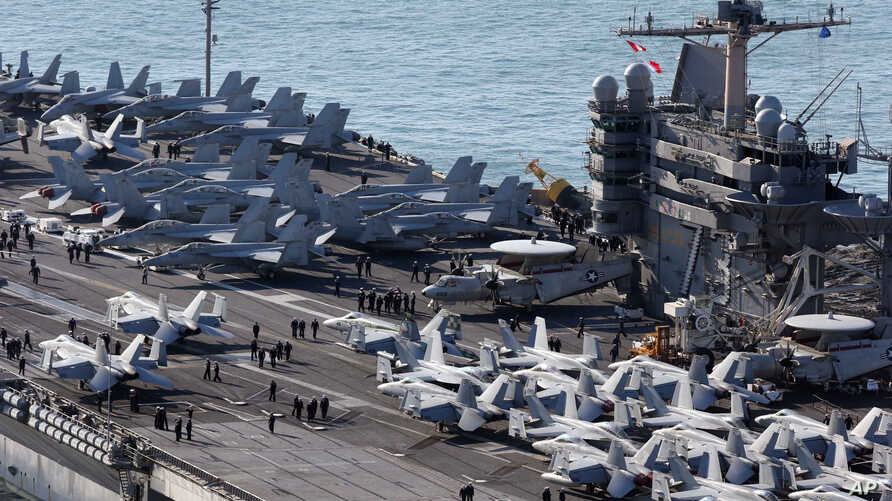 U.S. aircrafts sit on the flight deck of the USS George Washington at a navy port in Busan, South Korea, Oct. 4, 2013.