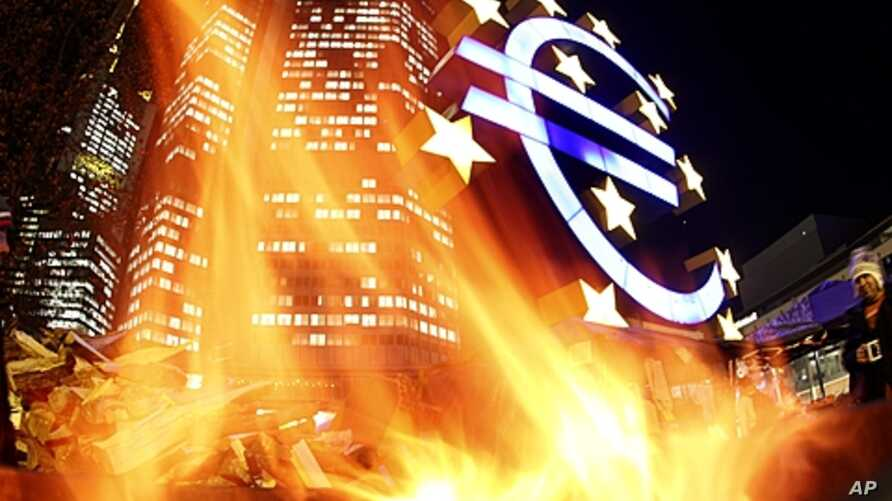 In this photo taken with a fisheye lens, flames from a fire set alight in a container by activists of the Frankfurt Occupy movement are seen in front of the European Central Bank and a sculpture of the euro symbol in Frankfurt, Germany, November 21,