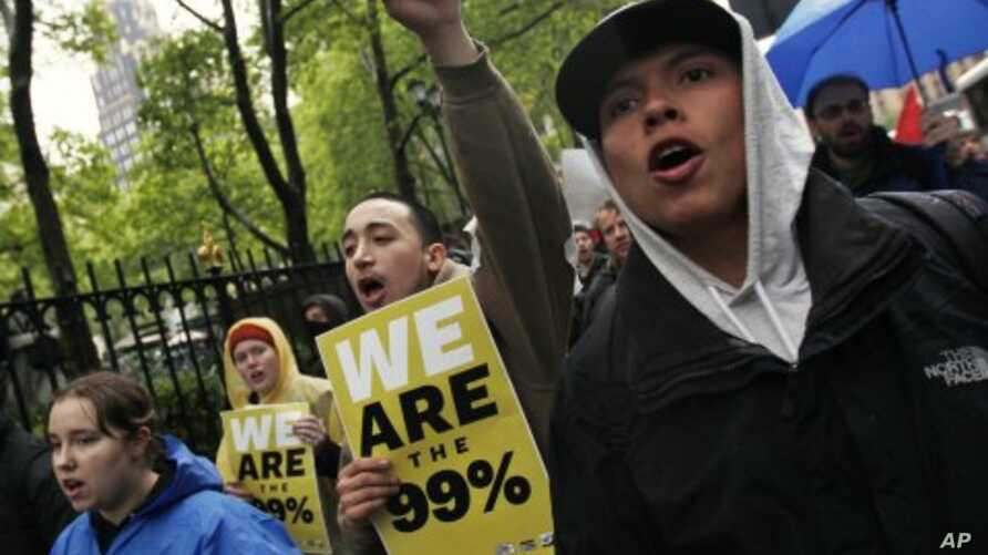 Occupy Wall Street protesters march to the Bank of America headquarters in New York, May 1, 2012.