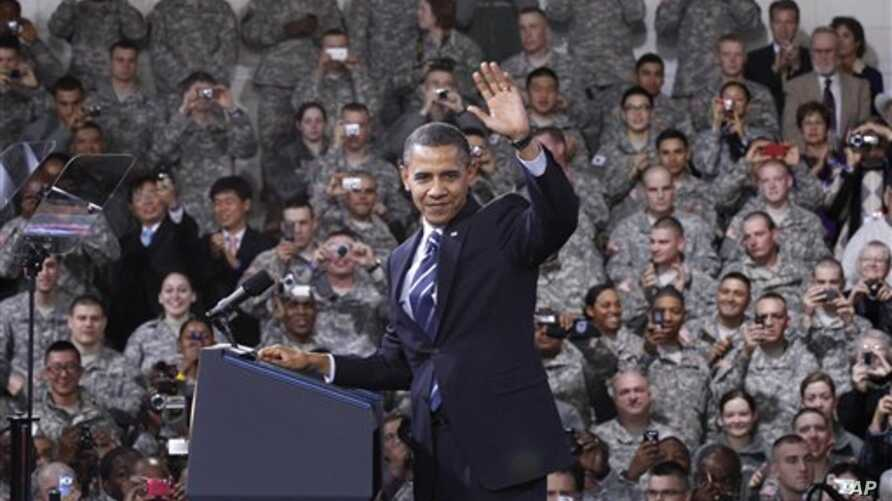 President Barack Obama waves to U.S. service members after being introduced at a Veteran's Day event at U.S. Army Garrison Yongsan in Seoul, South Korea, 11 Nov 2010