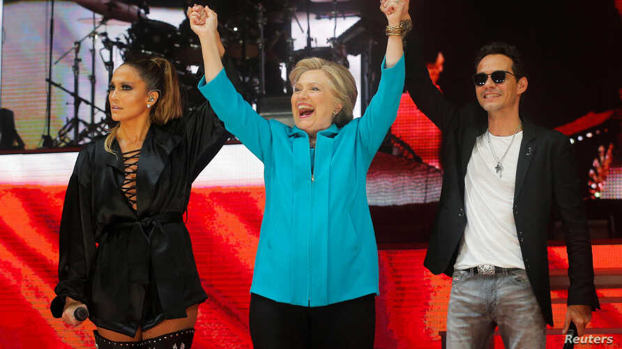 U.S. Democratic presidential nominee Hillary Clinton joins performers Jennifer Lopez and Marc Anthony at a campaign concert in Miami, Florida, Oct. 29, 2016.