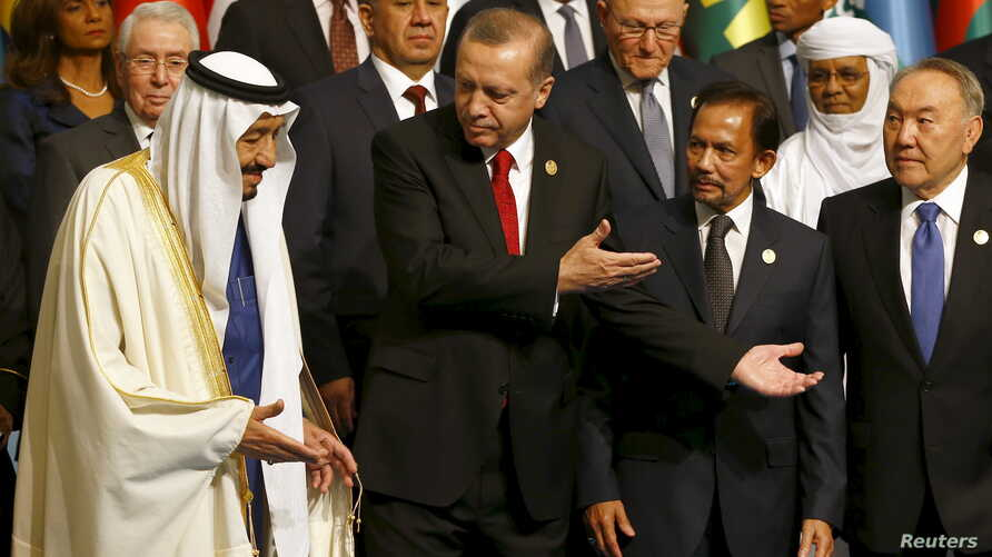 Turkish President Tayyip Erdogan (2nd L) is seen with King Salman of Saudi Arabia (L), Sultan of Brunei Hassanal Bolkiah (2nd R), and Kazakhstan's President Nursultan Nazarbayev (R) at a family photo session during the Organisation of Islamic Coopera