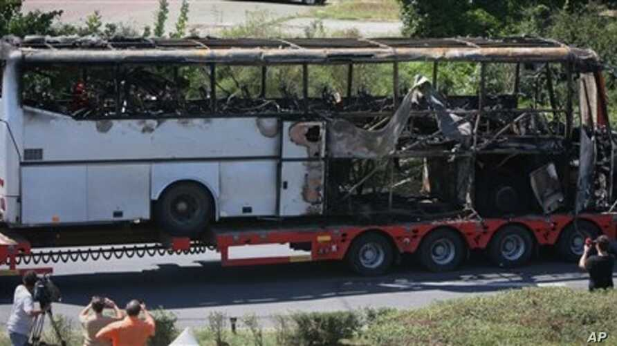 Bus destroyed in a deadly suicide attack on Israeli vacationers is transported out of Burgas airport, Bulgaria, July 19, 2012.