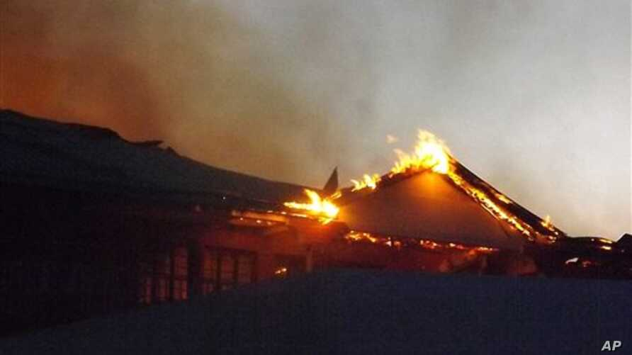 The Garissa Halgan Quran House Resort Hotel is engulfed in flames after Kenyan security personnel, according to residents, swept into the predominantly ethnic-Somali town beating people and burning property, northern Kenya, Nov. 19, 2012.