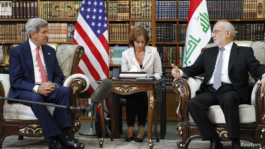 U.S. Secretary of State John Kerry meets with Iraq's Foreign Minister Ibrahim al-Jaafari (R) in Baghdad September 10, 2014.  Kerry said on Wednesday the international community would not sit and watch Islamic State grow and identified Iraq as a key p