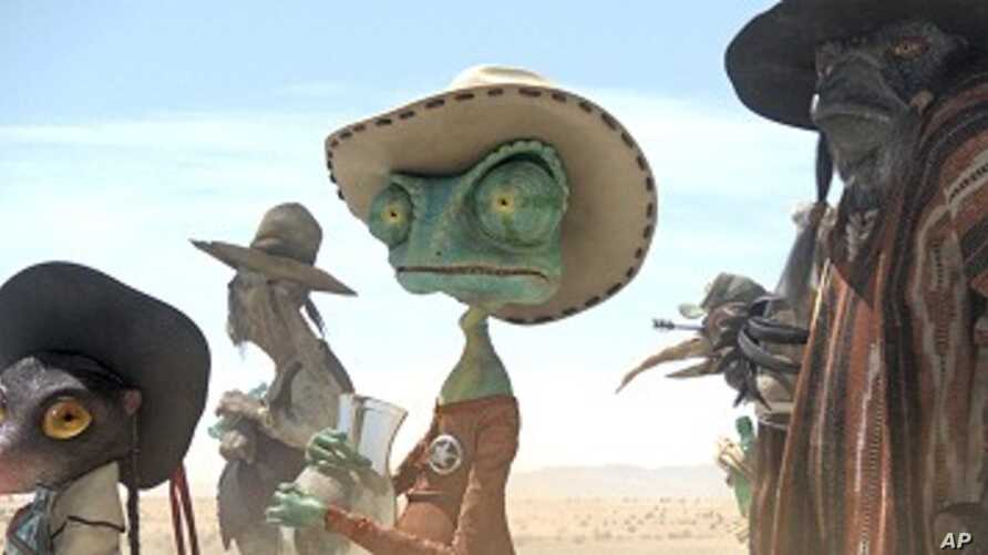 Left to right: Priscilla (Abigail Breslin), Rango (Johnny Depp), and Wounded Bird (Gil Birmingham) in RANGO, from Paramount Pictures and Nickelodeon Movies.