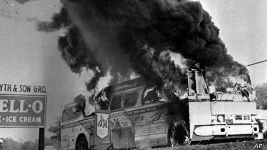 FILE -  A May 1961 file photograph of a Freedom Rider bus that went up in flames when a fire bomb was tossed through a window near Anniston, Alabama