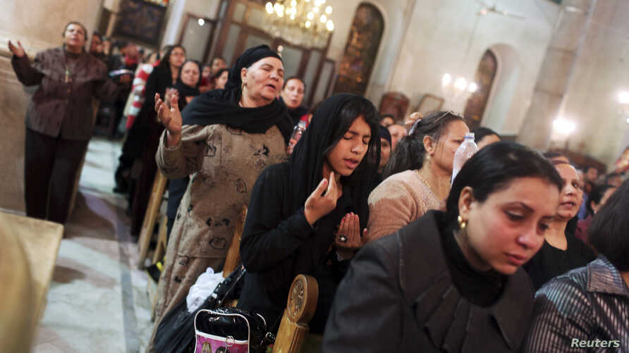 Coptic Christians pray at St Mark Cathedral in Cairo, Dec.26, 2014.