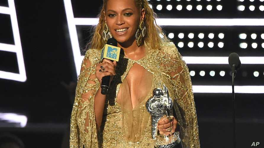 """Beyonce accepts the award for best female video for """"Hold Up"""" at the MTV Video Music Awards at Madison Square Garden on Sunday, Aug. 28, 2016."""